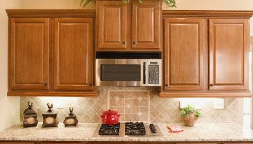 Cabinets make hanging a microwave easy, but they're not a necessity.