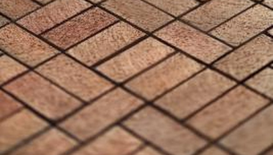 Keep red bricks vibrant with acid-based cleaning solutions.