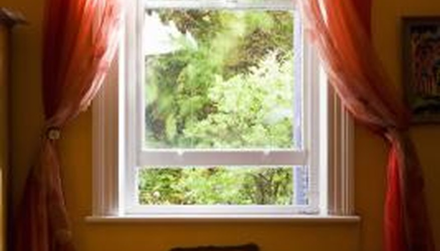 Vinyl replacement windows allow the sun inside while minimizing energy loss.