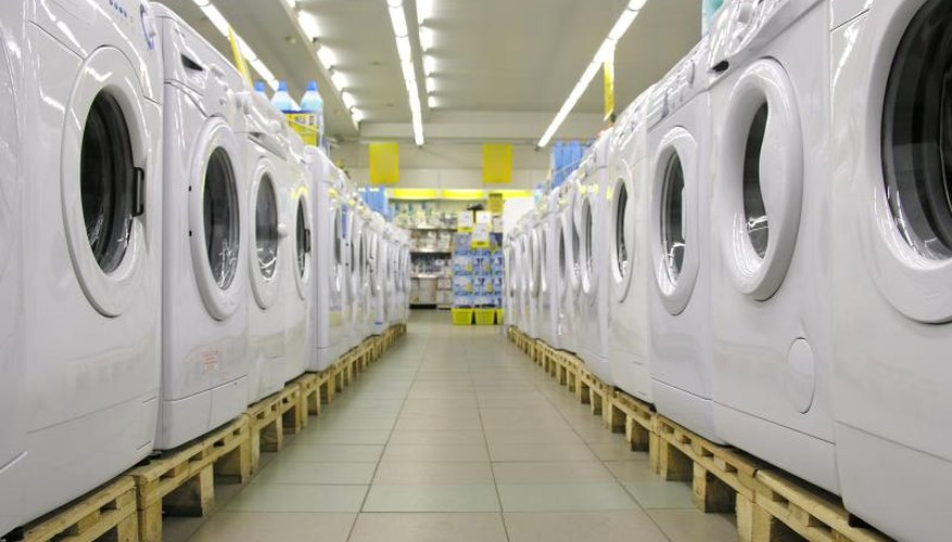 Rows of clothes dryers in a appliance store.