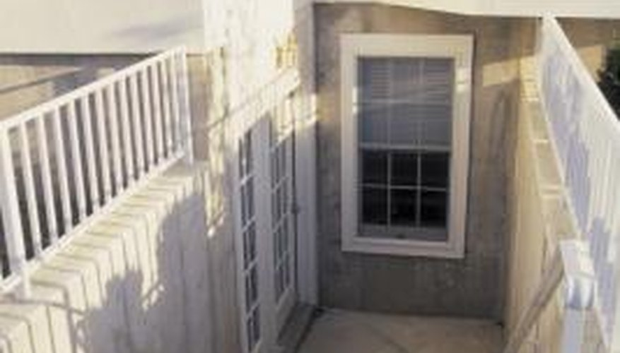 A sunken walkway or courtyard can replace a window well.
