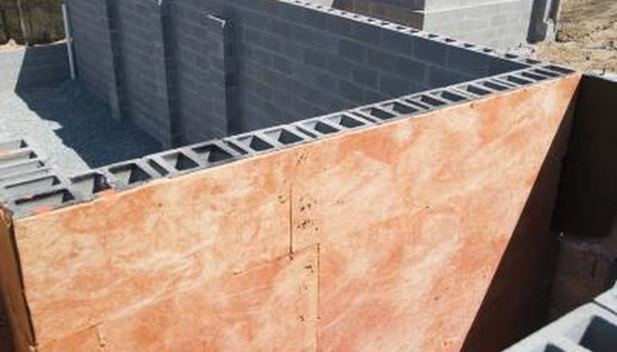 Tie masonry block securely to a concrete foundation for a well-built wall.