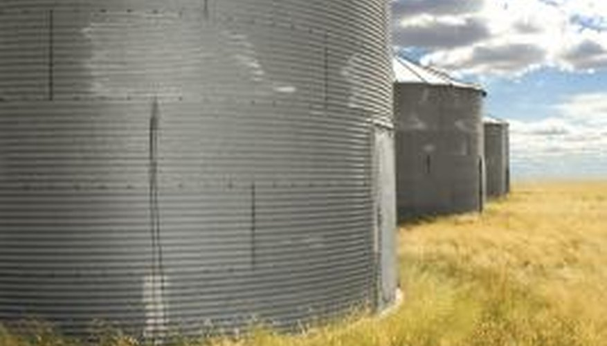 Concrete should extend beyond the grain bin to prevent water from getting inside.