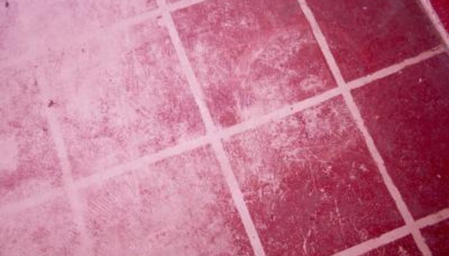 Sometimes painting over grout stains is the only cure.