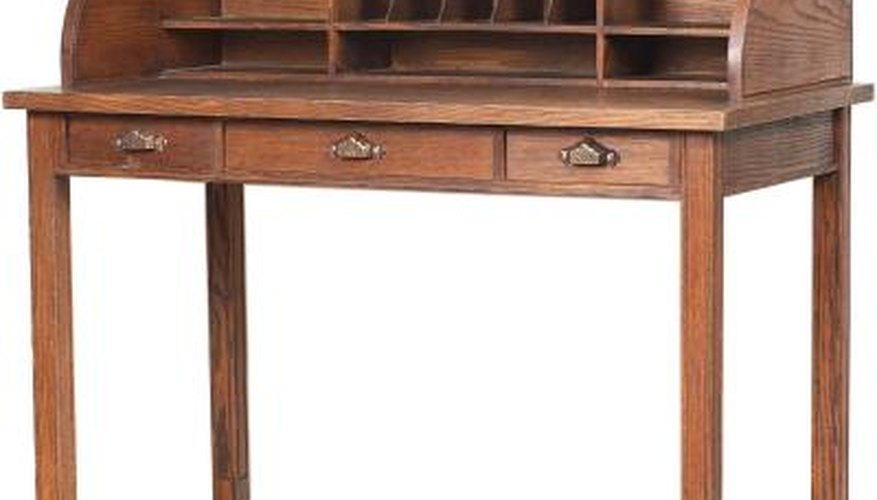 Drawer handles attach with a screw through the wood.