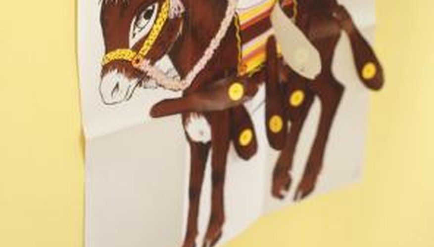 Putty is an ideal adhesive for hanging posters, especially for short-term purposes.