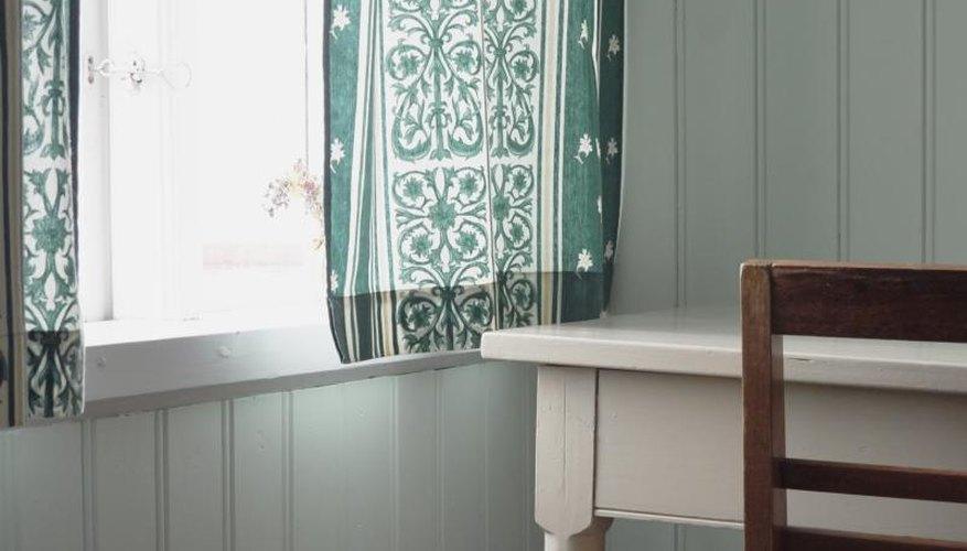 A gauzy bohemian fabric in the window of a beach house.