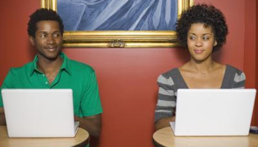 Young couple on laptops.