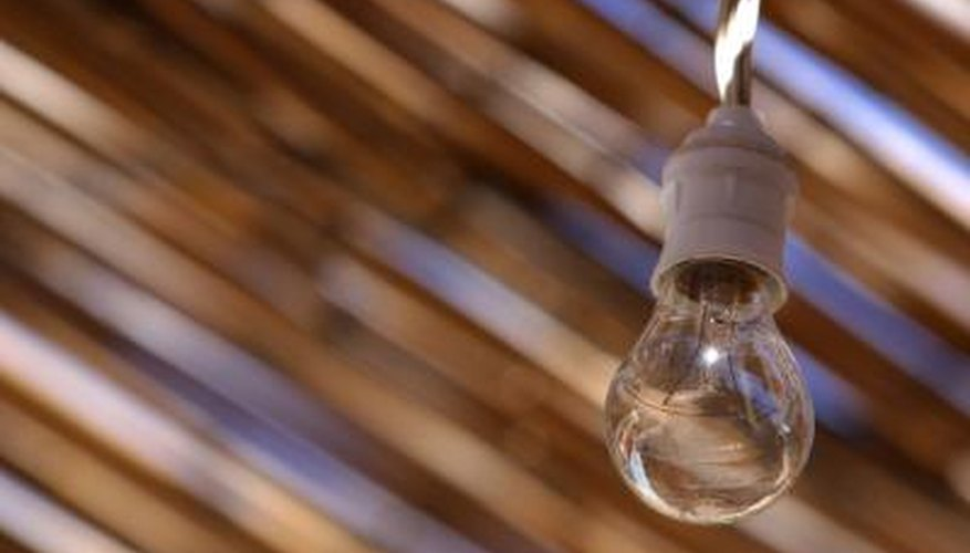 Start with the wired bulb, and then hang the glass orbs.
