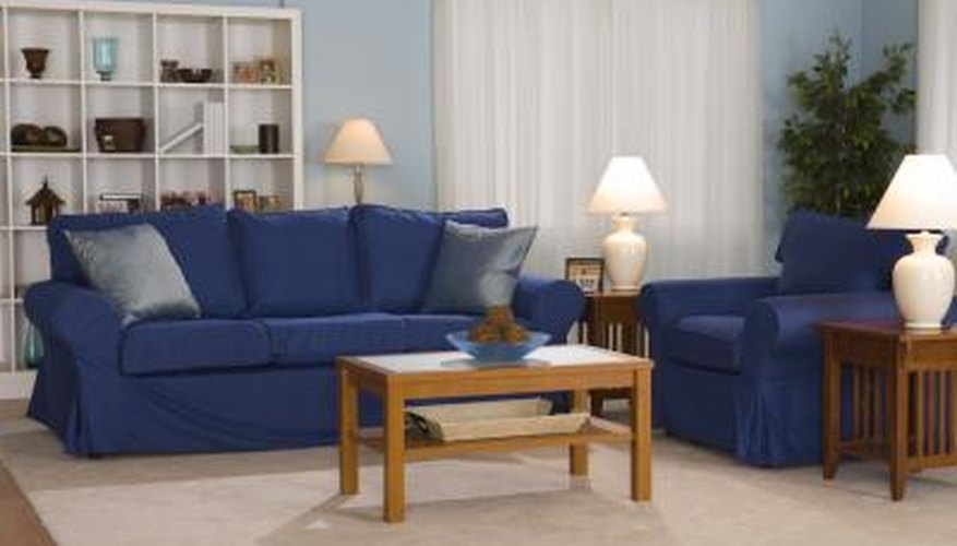 This Lawson style couch has rolled arms and a well-cushioned back.