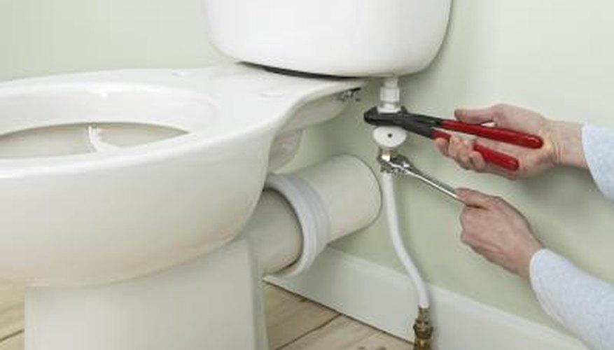 Man working on toilet