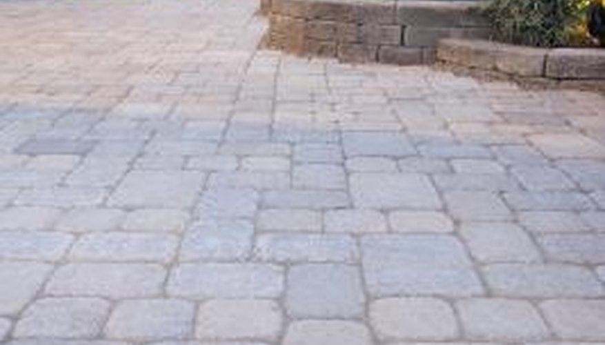 Prevent movement or cracking by attaching your pavers with construction adhesive.