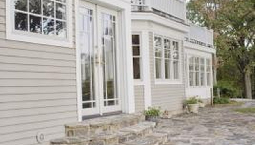 Clean the exterior of your home with a pressure washer.