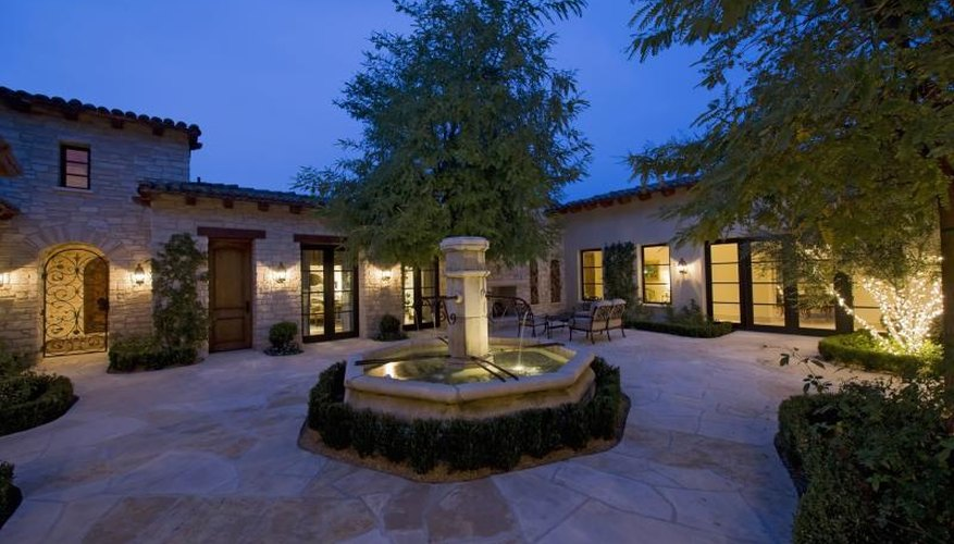 A Central Fountain And Clay Pavers Typify Hacienda Patio Style.