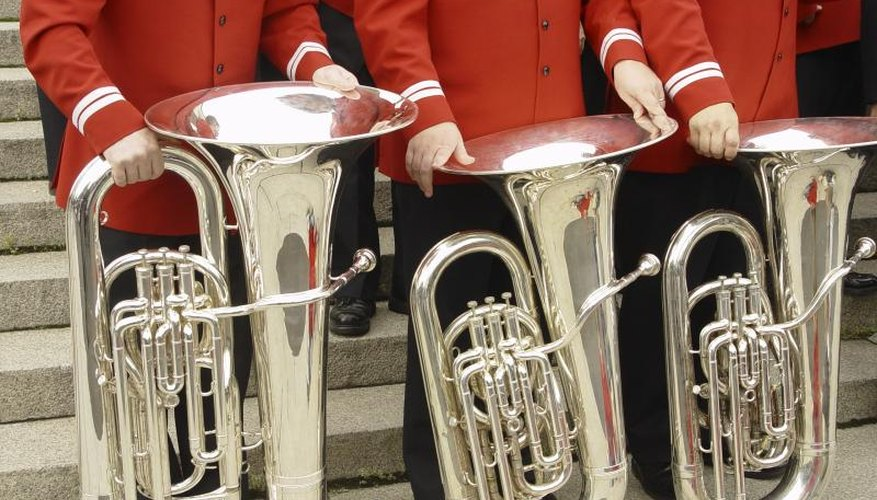 Tuba players in a marching band.