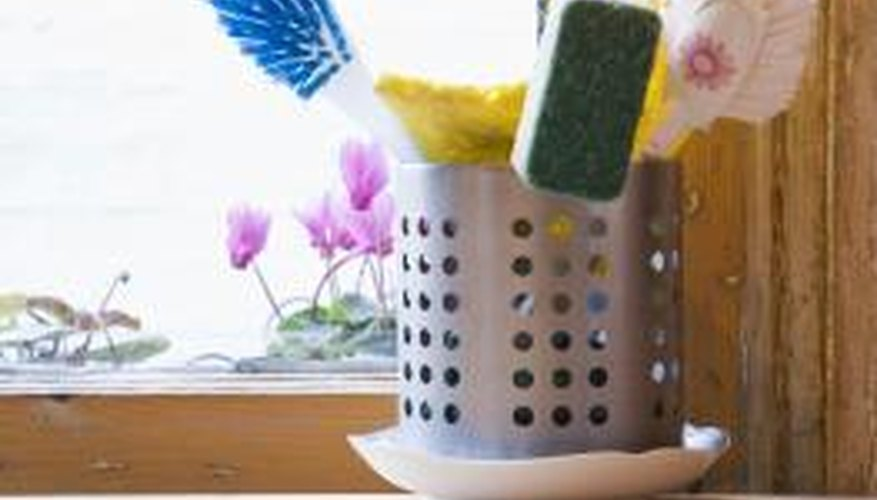 A scrub brush cleans natural grooves and crevices in brick.