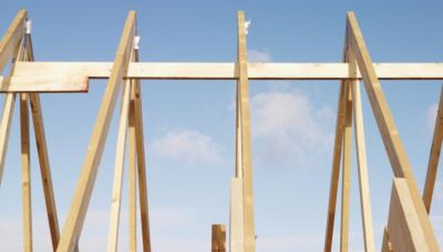 A framing square makes it easy to figure out how long rafters need to be for a project.