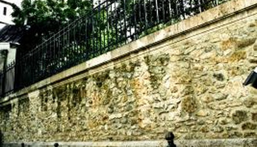 Railings may need to be installed on retaining walls for safety.