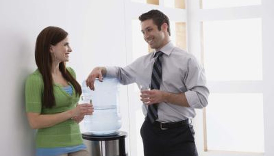 Coworkers talking at water cooler