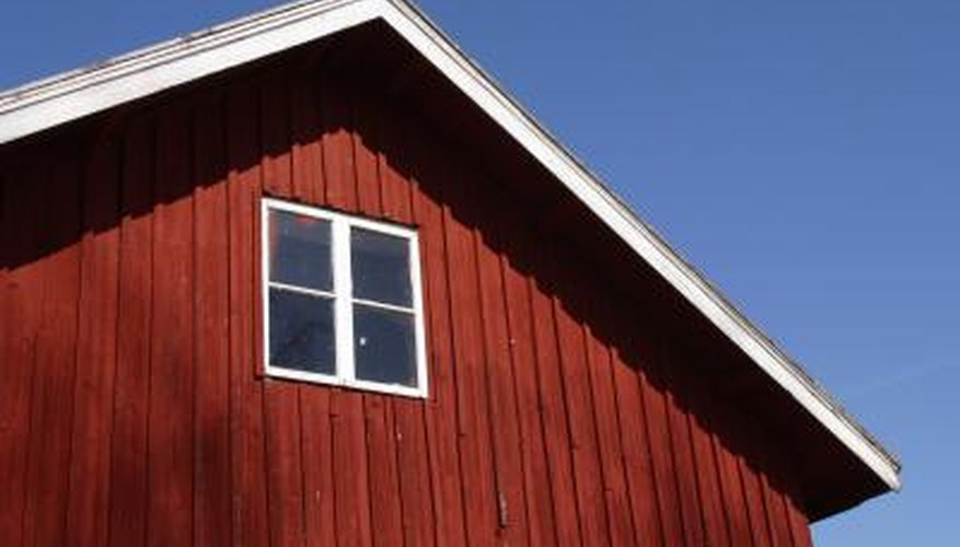Often rough-sawn, traditional board-and-batten siding consists of solid lumber.