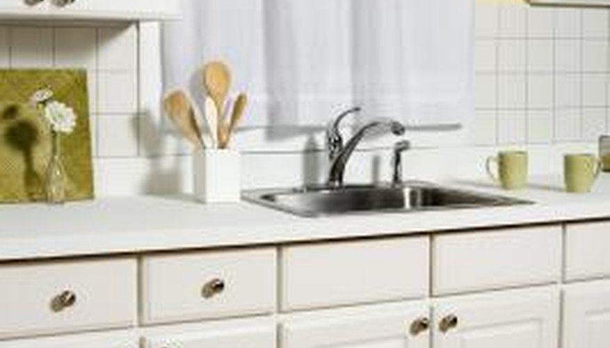 Backplates and larger hardware is an inexpensive way to spruce up cabinets.