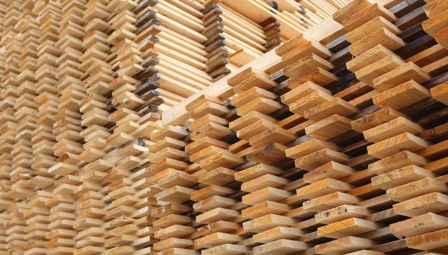 Stacks of pine planks at a lumber yard