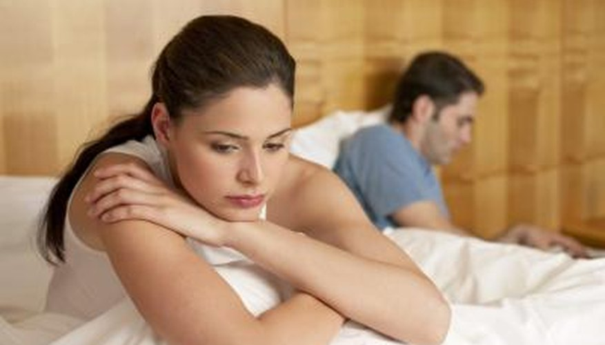 sad woman in bed with boyfriend