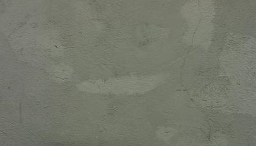 Prepare a concrete floor for tile with a waterproof sealant.