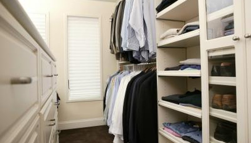 Adding built-in shelves and drawers provides more storage in a bedroom-converted closet.