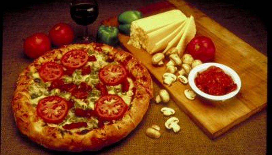 Pizza is but one food that can be cooked using a backyard pizza oven made from cinder blocks.