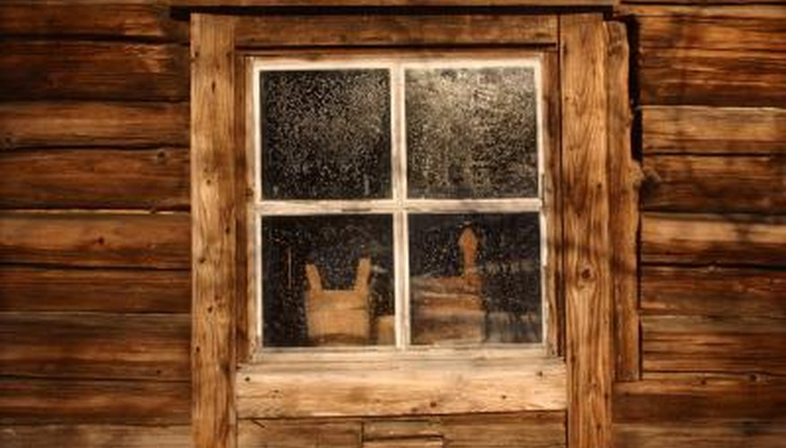 awesome log cabin window #6: Log cabin window frames may match the exterior wood or take on a  contrasting appearance.