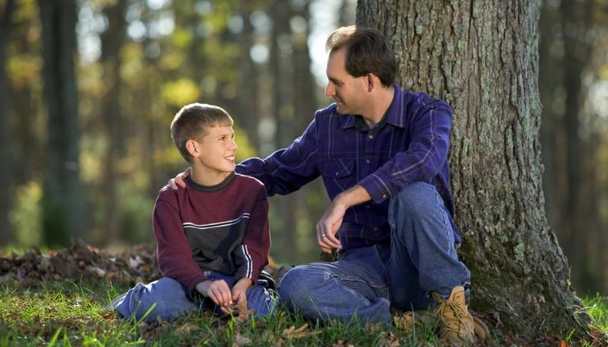 Father talking to son in park