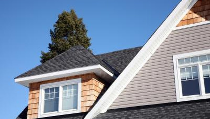 Dormers, Hip Roofs And Intersecting Gables Form Roof Ridges And Valleys.