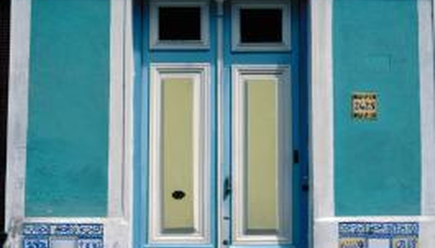 Painting a paneled door in multiple colors emphasizes the craftshmanship of the door.