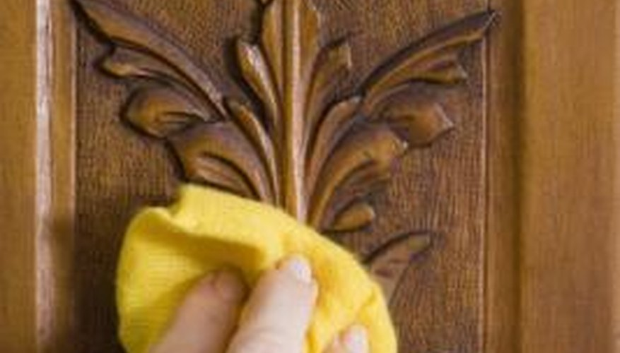 Buff wood by hand after varnishing.