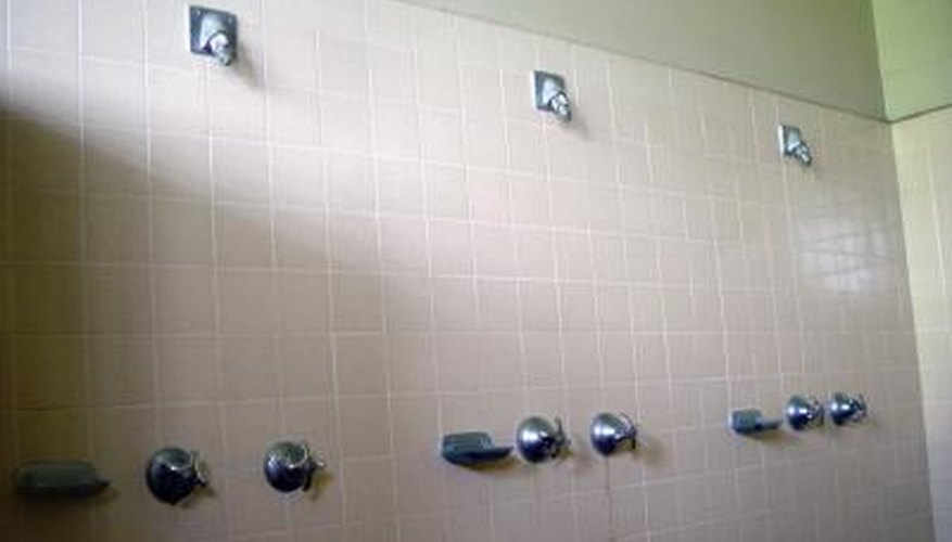 The walls above shower surrounds aren't always the same material.