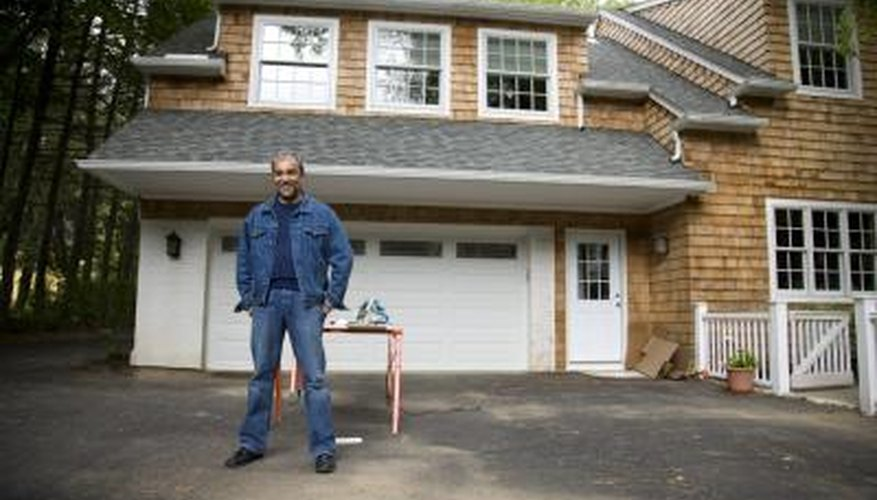 Remove driveway stains to maintain the appearance of your house.