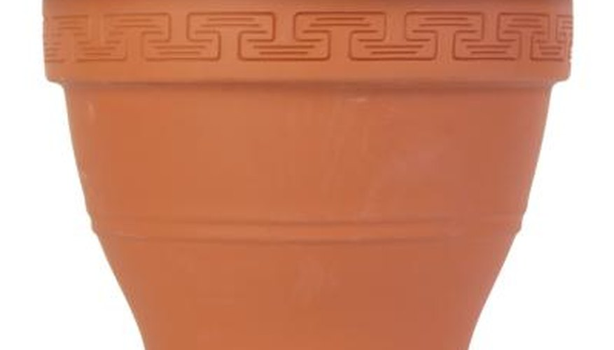 A large terracotta planter may be used to create a grill that cooks with high or low heat.