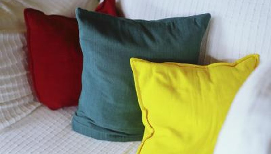 Decorative pillows can cover and draw attention away from an ugly couch.