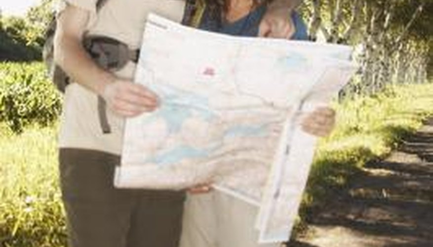 Couple looking at a map on hiking trail