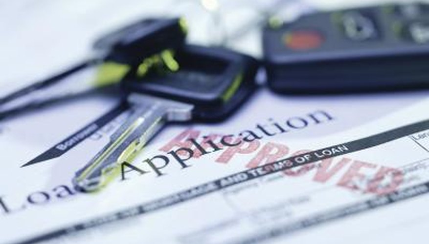 Car loan application paper and keys.