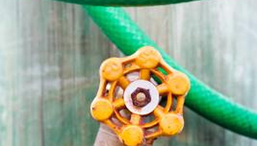 Use pipe dope or Teflon tape to stop leaking at a hose faucet.