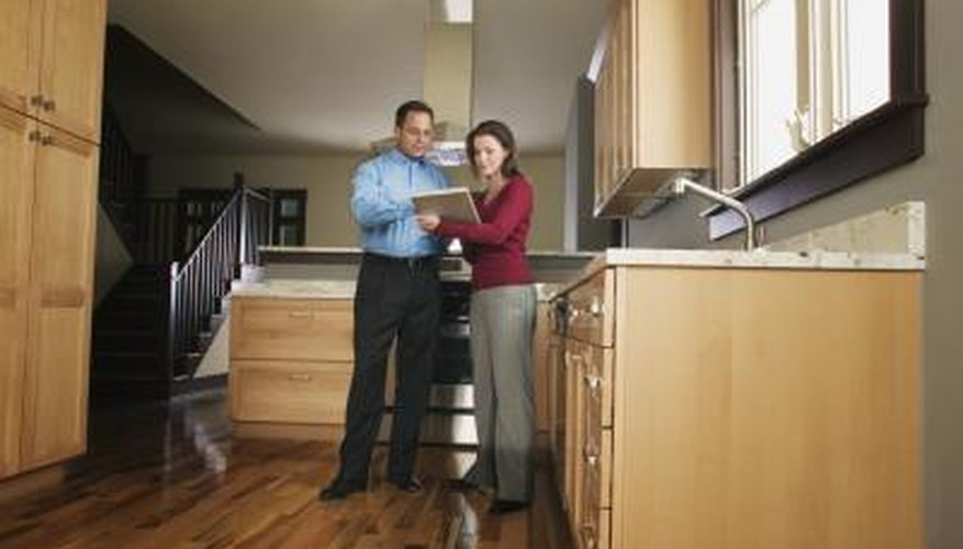 Couple inspecting kitchen