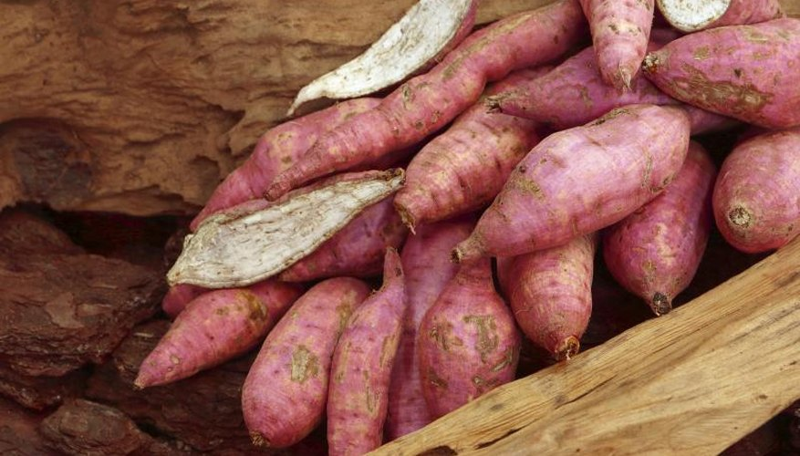 Sweet potatoes may have red skins or reddish flesh.