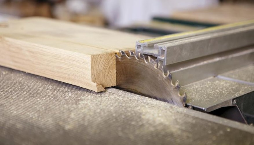 Circular saw cutting a piece of wood.