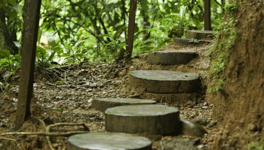 Make an organic wooden walkway with log rounds.