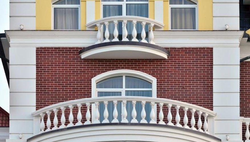 White vinyl railings on an opulent house.