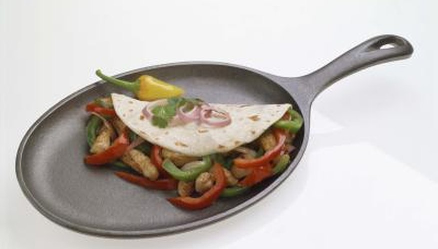 Foods are cooked on the surface of a griddle, making a high edge unnecessary.