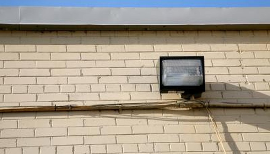 Floodlights are placed on buildings as a crime deterrent.