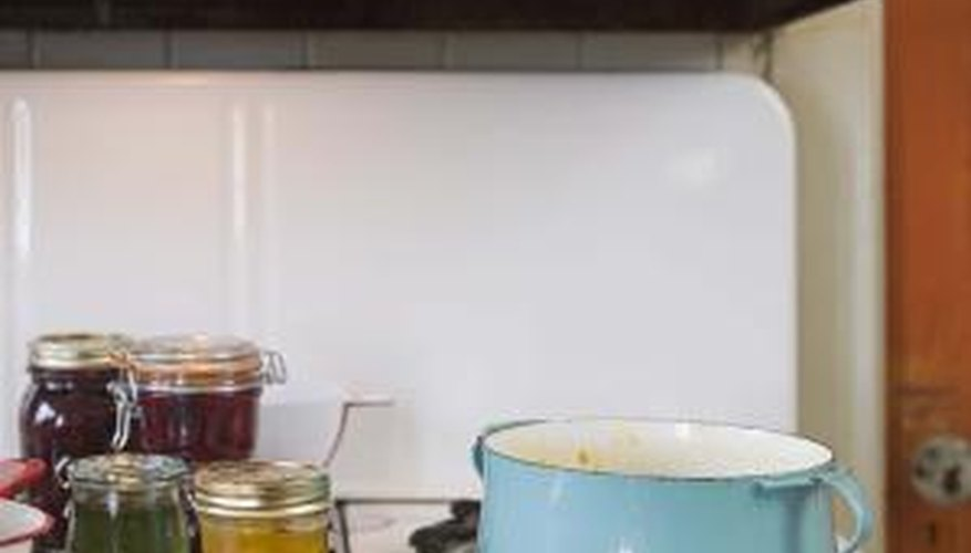 Enamel-coated, cast-iron pans are considered safe as long as the coating is not damaged.